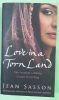 Pre- Owned Books - Love in a Torn Land Paperback by SASSON JEAN (Author)
