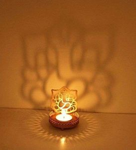 Golden Metal Decorative Shadow Divine Laxmi &GaneshaTealight Candle Holder (with 2 Tealight Candles) ( Pack of 2 )